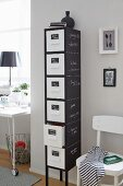 Tall, narrow chest of drawers with chalkboard sides