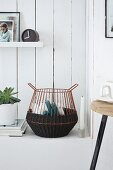 Hand-crafted wire basket wrapped in dark brown sisal cord