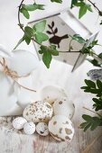 Speckled Easter eggs, china rabbit and tendrils of ivy