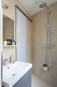Small bathroom with sliding door and open shower area