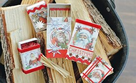 Matchboxes covered in vintage-style Father-Christmas-patterned paper