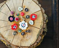 Hand-made buttons for traditional clothing on tree stump