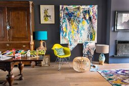 Grey walls and artworks in artistic living room