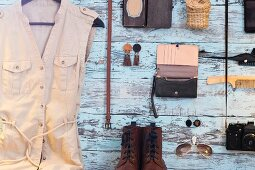 Clothing, accessories and utensils hung on pastel blue wall
