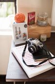 Camera and book on table