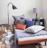 Scatter cushions in various colours on couch next to shoeboxes