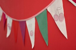 Bunting hand-made from fabric remnants with painted cherry motifs