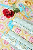 Linen napkins with coloured lace trim on plate