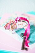 Key fob made from colourful origami paper and pink ribbon