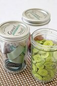 Sewing materials stored in screwtop jars