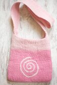 Hand-made pink felt bag with spiral motif