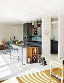 Elegant fitted kitchen with free-standing counter and open-fronted wooden shelves
