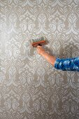 Pasting up patterned wallpaper using a wallpaper brush