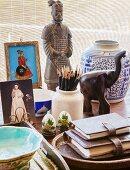 Porcelain jar, pen holder and ethnic objets d'art on desk