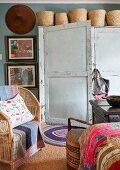 Baskets on top of vintage wardrobe in eclectic bedroom