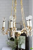 Vintage-style brass chandelier with light bulbs