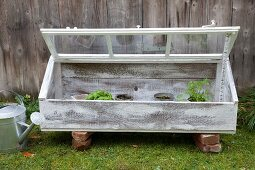 Cold frame made from boards and old window