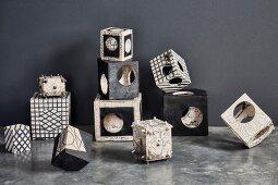 Still-life arrangement of various cubic, Japanese Raku ceramics