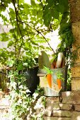 Metal bucket decorated with hand-made felt carrots in garden
