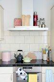 Retro kitchen utensils on kitchen counter with granite worksurface