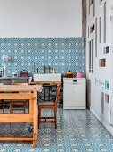 Ornate, blue and white wall and floor tiles in loft-apartment kitchen