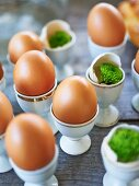 Eggs in egg cups on Easter buffet table