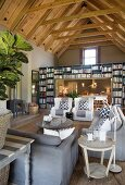 Exposed roof structure and bookcase in living room
