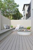 Masonry bench and hearth in modern courtyard