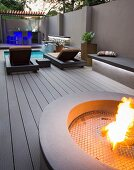 Modern courtyard with pool, hearth and bar