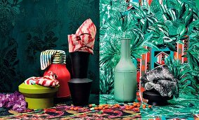 Colourful patterned fabrics, wallpaper and vases