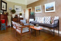 bench and upholstered chairs in eclectic living room