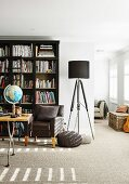 Open living room with carpeted floors and bookshelf