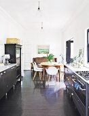 Eclectic dining area in black kitchen