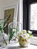 Flowers and succulents in vases and under glass cover