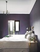 White bed and black walls in bedroom