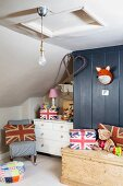 Child's bedroom with sloping ceiling an Union Flag motifs