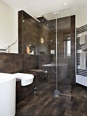 A purist and elegant design bathroom with brown tiles and a shower area with glass panels and a shower panel