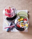Buttons and ribbons in screw-top jars with chalkboard-paint labels