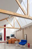 Modern living room with open roof structure and glass roof