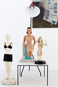 Three retro-style figurines of women