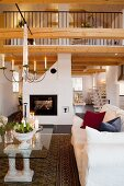 Fireplace, gallery and festive Advent atmosphere in open-plan living area of country house