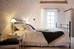 Vintage-style attic bedroom with fairy lights