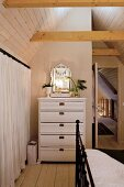 Christmas decorations on white chest of drawers in bedroom with vintage ambiance
