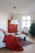 Christmas tree and red accents in Scandinavian living room