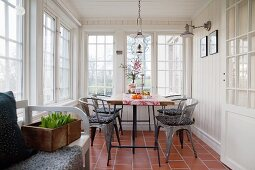 Rustic conservatory with lattice windows and dining table