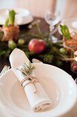 White place setting with festively decorated linen napkin
