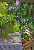 Set garden table decorated with lavender and snail shells