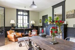 Leather armchairs and rustic tables in living area with traditional ambiance