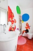 Guest WC with pin-up murals and magazine rack on wall