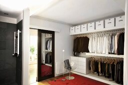 Mirrored sliding doors in elegant, masculine dressing room